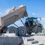 truck offloading stones